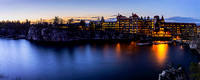 Panoramic photograph of the historic Mohonk Mountain House and lake at sunset with a long exposure