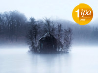 Abandoned building surrounded by trees, water and fog in Tarrytown, Westchester County, NY
